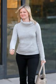 Amy Smart looked cozy on a winter day in this speckled gray turtleneck with a sweatshirt pocket.