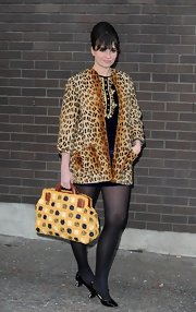 Gizzi Erskine chose a leopard printed fur coat for her chic mod-inspired look at An Evening with Chickenshed.