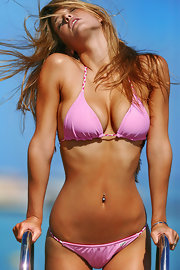 Bar Refaeli wore a simple pink bikini tiny rope ties for her swimsuit photo shoot.