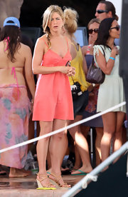 Jen paired her coral sun dress with tan strappy wedges.