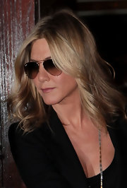 Jennifer Aniston's hair looked fantastic while she was out and about in NYC. To duplicate her look, add a few waves to shoulder-length hair using a large-barreled curling iron and tousle with fingers.