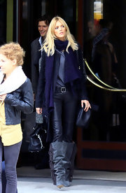 Anja Rubik was out and about in Poland rocking a pair of slouchy gray suede boots and leather pants.