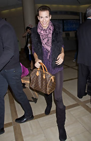 Rachel Mccord arrived at LAX carrying a stylish Louis Vuitton tote.