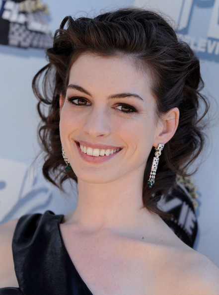 Happy birthday Anne Hathaway! See the star's stunning style Watch the video above for 5 tips to wear. a leather skater skirt for every style FOLLOW