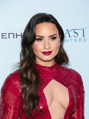 Demi Lovato swiped on some red lipstick to match her sexy outfit.