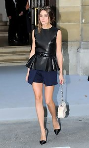 Olivia Palermo wore a belted leather top with a pleated peplum for the Dior Couture show in Paris.