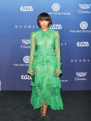 Kat Graham charmed in a bright green lace gown by Erdem at the Art of Elysium celebration.