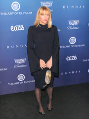 Courtney Love complemented her dress with black buckle-embellished pumps.
