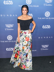 Emmanuelle Chriqui dressed up her top with a floral maxi skirt, also by Alice + Olivia.