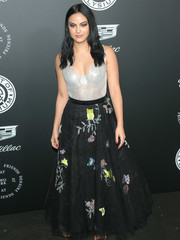 Camila Mendes looked captivating at the Art of Elysium Heaven Gala in a two-tone Fabiana Milazzo lace gown with whimsical flora-and-fauna embroidery on the skirt.