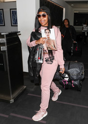Ashanti went matchy-matchy with this pink Moschino sweatpants and crop-top combo.
