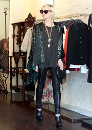 Ashlee Simpson hit in the shops in Sydney, Australia wearing a pair of ultra-high black leather wedges.