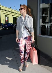 Minka Kelly pared down her print pants with this gray open front cardigan.