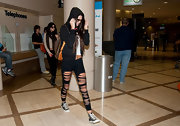 Kendall went for comfort in a pair of lace-up high-tops at the airport.