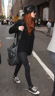 Ashlee adds this black balenciaga bag to her all black attire.