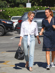 Ashley Greene ran errands in LA wearing a white Faithfull The Brand tie-waist button-down shirt.