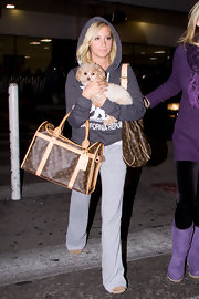 Ashley Tisdale is seen traveling through LAX with her cute pooch and leather designer bag. She kept things low-key while on her time off, but she always manages to stay stylish.