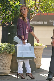 Audrina dresses up her look with this Chanel over-the-shoulder purse.