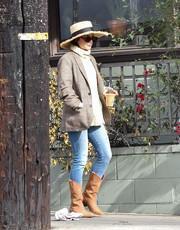 Vanessa Hudgens added a Western-chic touch with a pair of camel-colored cowboy boots by Gerard Darel.