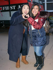 Awkwafina completed her cold-weather look with a pair of tan Ugg boots.
