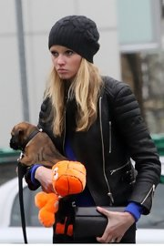 Lara Stone wore this charcoal beanie while out with her puppy in London.