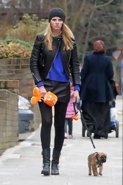 Lara Stone toughened her dog walking look with a leather jacket and motorcycle boots.