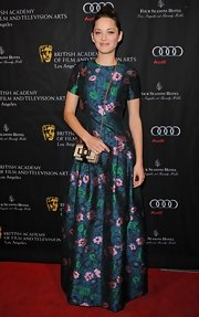 Marion looked positively ladylike in this floral brocade gown with short sleeves and floor-grazing length.