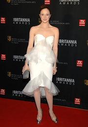 Andrea Riseborough wore a white strapless dress with organza ruffles for the BAFTA Britannia Awards.