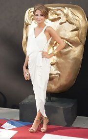 Millie Mackintosh completed her Greek-inspired look at the 2012 BAFTA awards with a pair of strappy sandals by Lanvin.