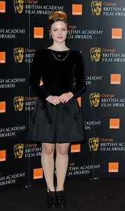 Holliday Grainger matched her top with a tonal flared skirt for the BAFTA announcement.