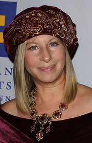 Barbra Streisand topped off her outfit with a beaded embroidered velvet turban when she was honored with the Humanitarian Award.