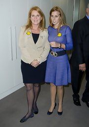 Sarah Ferguson topped off her navy blue dress with a classic cream blazer at the BGC Charity Day.