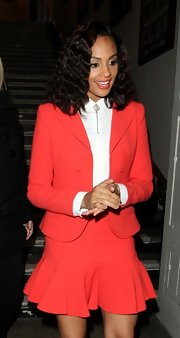 A flare mini put a feminine spin on Alesha Dixon's bright coral skirt suit.