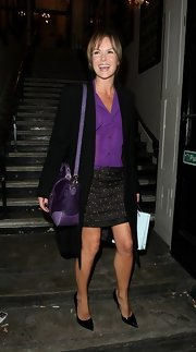 With pointed-toe black pumps and a miniskirt, Amanda Holden's legs were on show as she left the Palladium.
