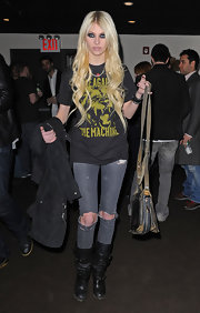 """Gossip Girl"" Taylor Momsen is seen here in all her grunge glory while preforming at a BMI event. She went for a classic rock look, a vintage tee-shirt, cut-up jeans and a pair of distressed leather boots completed her look."