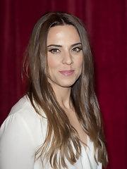 Sleek, straight hair framed Melanie Chisholm's pretty face at the British Soap Awards.