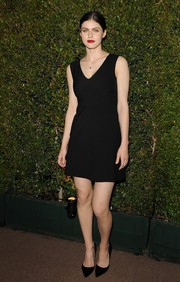 Alexandra Daddario attended the Decades of Glamour Oscar party wearing a basic little black dress.