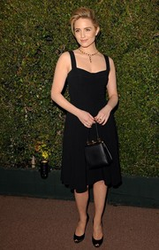 Dianna Agron looked timeless in her Dolce & Gabbana LBD during the Decades of Glamour Oscar party.