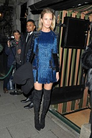 Poppy Delevingne rocked some major fringe with this metallic blue mini dress during the Balmain party.
