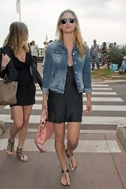 Bar Refaeli topped off her black silk frock with a casual denim jacket while out and about at Cannes.