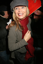 Barbara Bach's red scarf brought a bright pop of color to her subdued outfit.