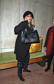 Barbra Streisand's black crocodile tote was an elegant addition to her shopping ensemble.