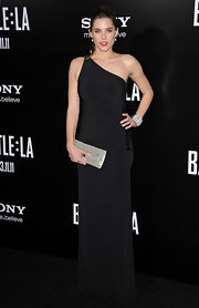 Susie Abromeit added contrast to her black evening dress with a metallic silver clutch.