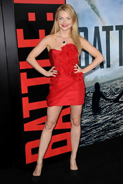 Izabella wears bold red to the 'Battle: LA' premiere in a ruffled strapless confection.