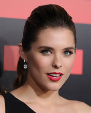Susie Abromeit paired her sleek ponytail with a diamond drop earrings.
