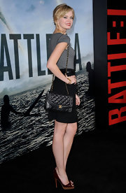 Sara Paxton added a touch of color ot her look with burgundy patent peeptoes with wooden platforms.