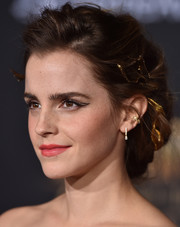 For her beauty look, Emma Watson went playful with a hollow cat eye.