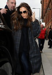 Victoria Beckham showed off her classically sophisticated style with an over-sized plaid wool coat while hitting the London streets.