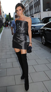 Victoria looked got in a strapless Giles LBD with suede RZ over the knee boots.