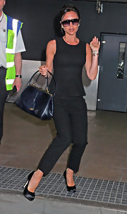 The always polished Mrs. Beckham stepped out in an all black ensemble completed by a pair of satin platform pumps.